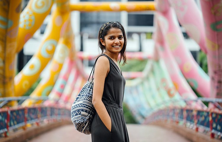 Attractive and young Indian woman walking