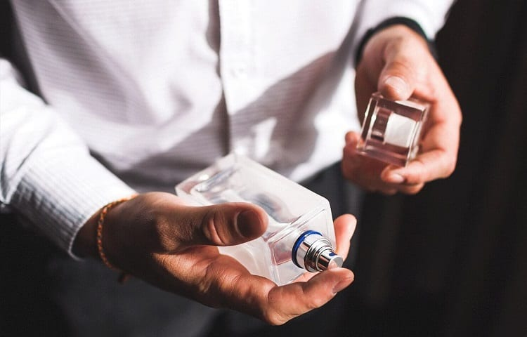 perfume in mans hand